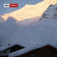 Avalanche envelopes Swiss village