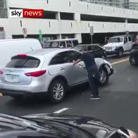 Man takes hammer to car escaping after crash