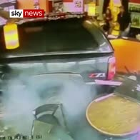 SUV reverses into cafe