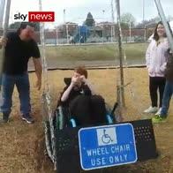 Boy's joy on wheelchair enabled swing
