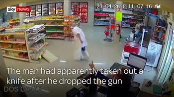 Hero 'cowboy' tackles armed robber