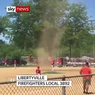 Mini dust devil sweeps through baseball game