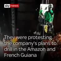 Greenpeace abseil into oil company meeting