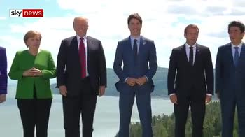 G7 leaders gather for family photo
