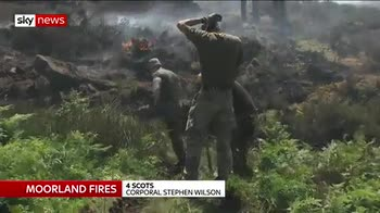 Man arrested as moorland blaze continues