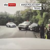 Cop saves woman from path of vehicle