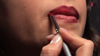 Make up per le feste. Labbra rosso porpora